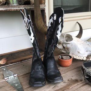 Matching pair Tony Lama boots and Nocona belt.